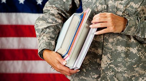 military service member holding books