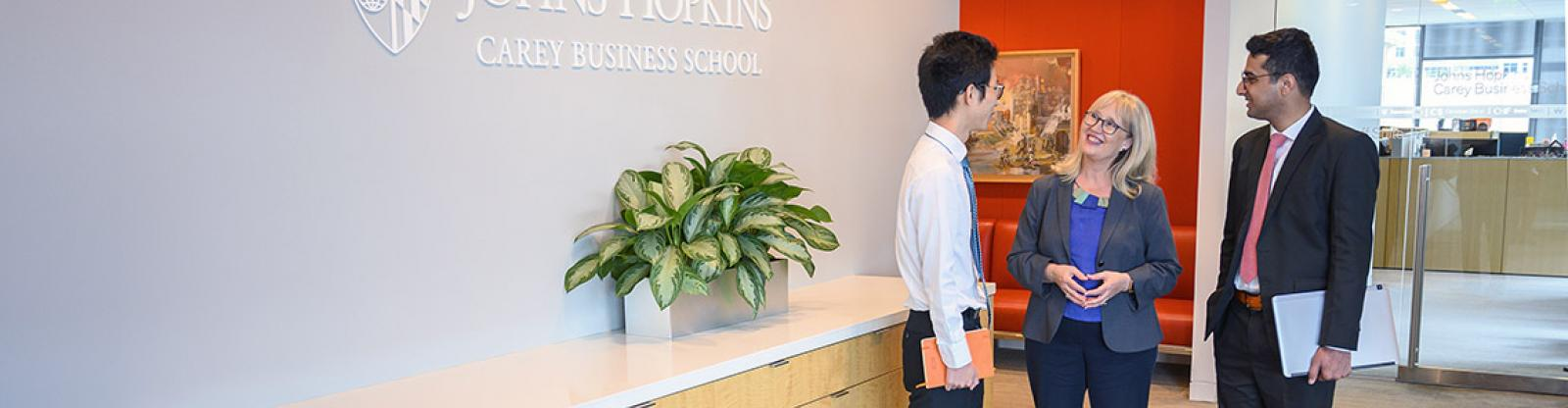 students talking with a career development coach at johns hopkins carey business school