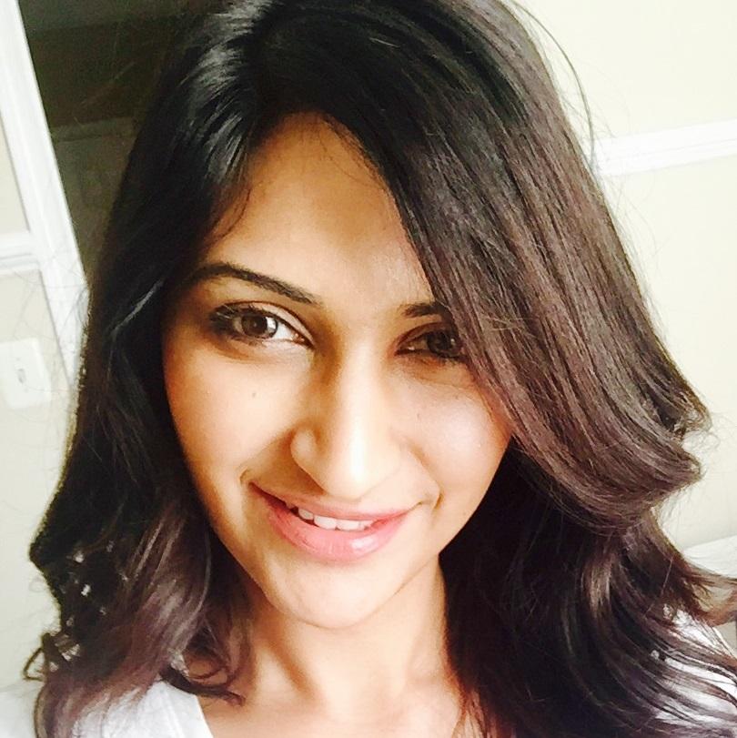carey business school Veena Radhakrishnan